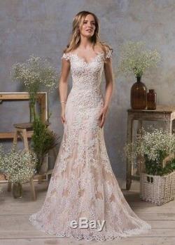 Champagne Robes De Mariée Robes De Mariée Gaine Sans Manches Taille Plus Sirène
